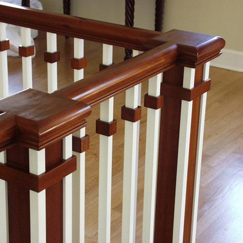 Earthwood builders inc for Stair railing designs interior
